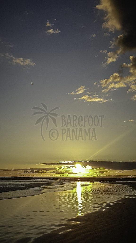 yellow-sunset-over-beach